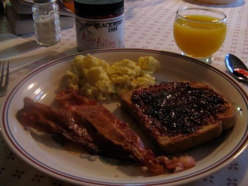 scrambled eggs, toast, bacon